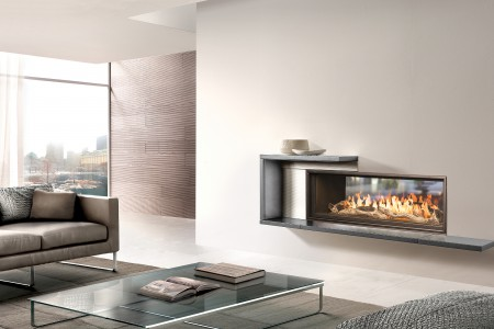WS54 See-Thru Indoor-Outdoor fireplace with Black Diamond burner and optional Long Beach logset in a indoor room setting installed with a Piazzetta surround