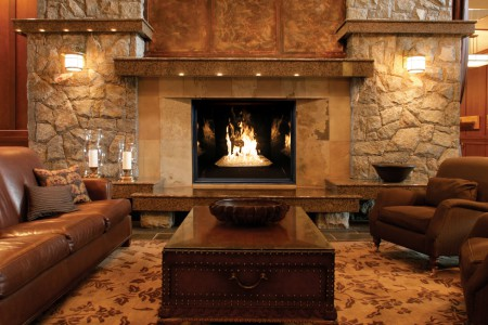 TC54 fireplace with Black Diamond burner, Twilight Diamond glass media, and black porcelain firebox panels in hotel lobby setting