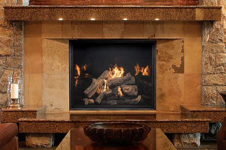 TC54 fireplace with Country Home log set and black porcelain firebox panels in hotel lobby setting