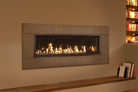 WS54 linear fireplace with Black Diamond burner and graphite widescreen surround in room setting